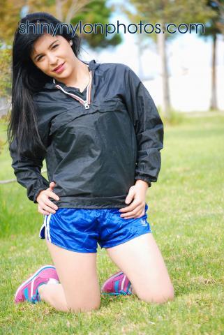 Blue adidas shiny nylon shorts and k-way rainjacket