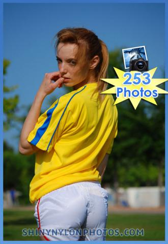 White adidas nylon shorts and yellow t-shirt