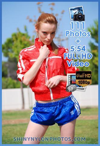 Blue sprinter nylon shorts and red nylon jacket