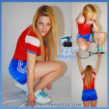 Blue nylon shorts and red nylon t-shirt.