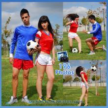 White adidas nylon shorts and red t-shirt